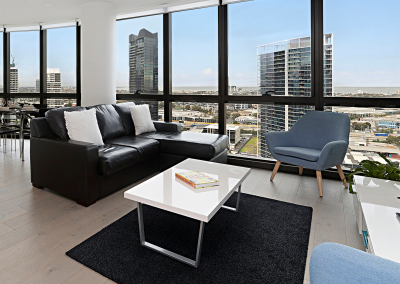 Living area in 3 bedroom premium apartment with views over the Yarra and bay